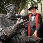 John Blatchly with 'his' statue of Thomas Wolsey.